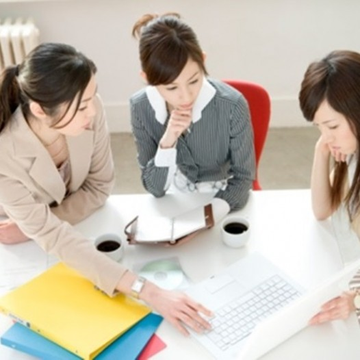 Three women having meeting at desk
